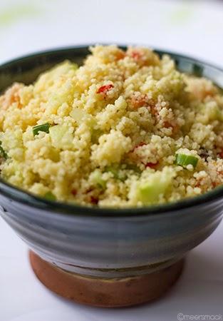 Couscous salade met rozijnen in kom